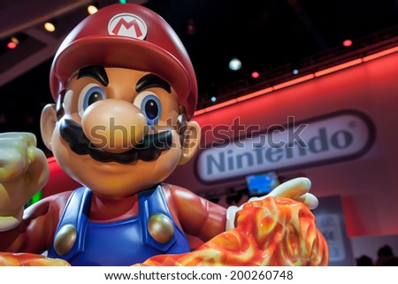 LOS ANGELES - JUNE 12: giant Super Mario statue and Nintendo logo at E3 2014, the Expo for video games on June 12, 2014 in Los Angeles - stock photo