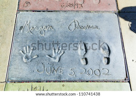 LOS ANGELES - JUNE 26:  handprints of Morgan Freeman in Hollywood Boulevard on June 26,2012 in Los Angeles. There are nearly 200 celebrity handprints in the concrete of Chinese Theatre's forecourt. - stock photo