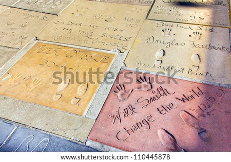 LOS ANGELES - JUNE 26:  handprints of Will Smith and Peter o Toole on June 26,2012 in Los Angeles. There are nearly 200 celebrity handprints in the concrete of Chinese Theatre's forecourt. - stock photo