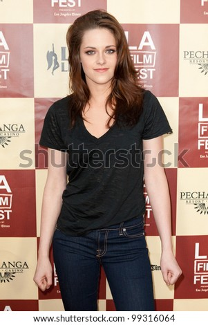 LOS ANGELES - JUNE 21: Kristen Stewart arrives at the Los Angeles Film festival premiere of 'A Better Life' on June 21, 2011 in Los Angeles, CA - stock photo