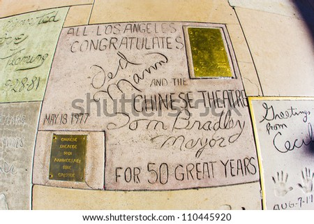 LOS ANGELES - JUNE 26:  Signature of Ted Mann and Tom Bradley in Hollywood BLVD on June 26,2012 in Los Angeles. There are nearly 200 celebrity handprints in the concrete of Chinese Theatres forecourt. - stock photo