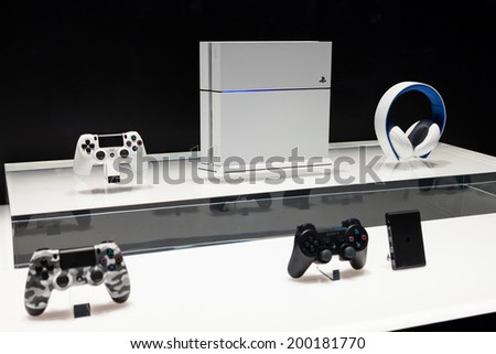LOS ANGELES - JUNE 12: Sony unveiling white PlayStation 4 model and accessories for the first time  at E3 2014, the Expo for video games on June 12, 2014 in Los Angeles - stock photo