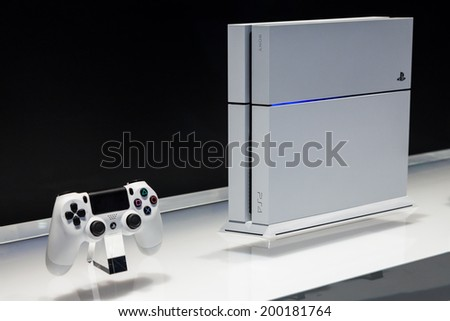 LOS ANGELES - JUNE 12:  Sony unveiling white PlayStation 4 model for the first time at E3 2014, the Expo for video games on June 12, 2014 in Los Angeles - stock photo