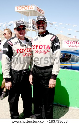 LOS ANGELES - MAR 15:  Al Unser Jr, Kyle Petty at the Toyota Grand Prix of Long Beach Pro-Celebrity Race Training at Willow Springs International Speedway on March 15, 2014 in Rosamond, CA - stock photo