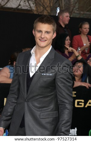"LOS ANGELES - MAR 12:  Alexander Ludwig arrives at the ""Hunger Games"" Premiere at the Nokia Theater at LA Live on March 12, 2012 in Los Angeles, CA"