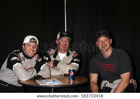 LOS ANGELES - MAR 15:  Brett Davern, Al Unser Jr, Cole Hauser at the Toyota Grand Prix of LB Pro-Celebrity Race Training at Willow Springs Speedway on March 15, 2014 in Rosamond, CA - stock photo