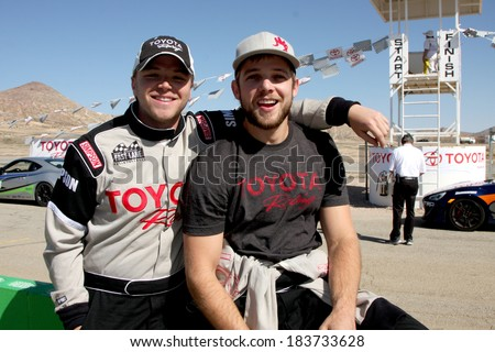 LOS ANGELES - MAR 15:  Brett Davern, Max Thieriot at the Toyota Grand Prix of Long Beach Pro-Celebrity Race Training at Willow Springs International Speedway on March 15, 2014 in Rosamond, CA - stock photo