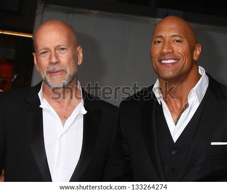 """LOS ANGELES - MAR 28:  Bruce Willis, Dwayne Johnson arrives at the """"G.I. Joe: Retaliation""""  LA Premiere at the Chinese Theater on March 28, 2013 in Los Angeles, CA - stock photo"""