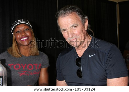 LOS ANGELES - MAR 15:  Carmelita Jeter, Eric Braeden at the Toyota Grand Prix of Long Beach Pro-Celebrity Race Training at Willow Springs International Speedway on March 15, 2014 in Rosamond, CA - stock photo