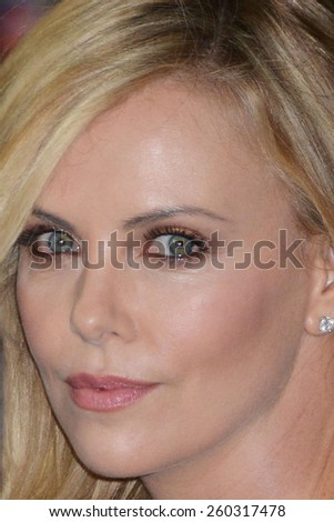 """LOS ANGELES - MAR 12:  Charlize Theron at the """"The Gunman"""" Premiere at the Regal 14 Theaters on March 12, 2015 in Los Angeles, CA - stock photo"""
