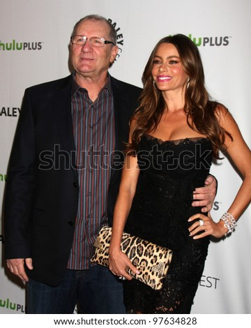 """LOS ANGELES - MAR 14:  Ed O'Neill, Sofia Vergara arrives at the """"Modern Family"""" PaleyFest Event at the Saban Theater on March 14, 2012 in Los Angeles, CA - stock photo"""