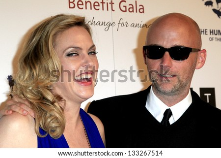 LOS ANGELES - MAR 23:  Elaine Hendrix, Moby arrives at the 2013 Genesis Awards Benefit Gala at the Beverly Hilton Hotel on March 23, 2013 in Beverly Hills, CA - stock photo