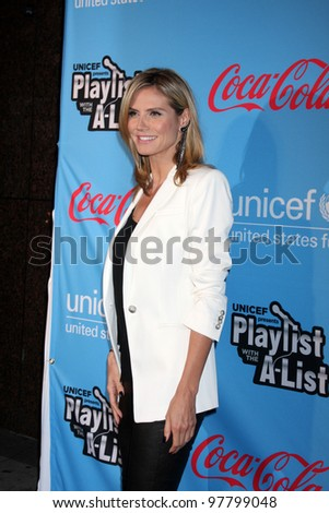"""LOS ANGELES - MAR 15:  Heidi Klum arrives at the """"UNICEF Playlist With The A-List"""" Concert at the El Rey Theater on March 15, 2012 in Los Angeles, CA - stock photo"""