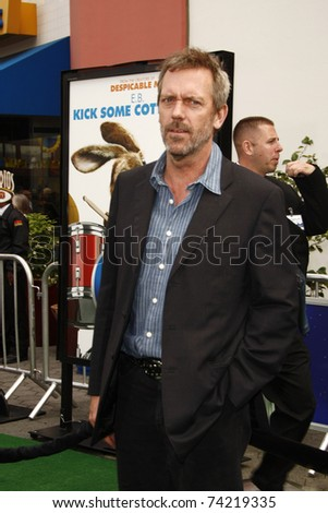 LOS ANGELES - MAR 27:  Hugh Laurie arrives at the World Premiere of 'HOP' held at Universal Studios Hollywood on March 27, 2011 in Los Angeles, California - stock photo