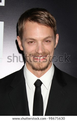 """LOS ANGELES - MAR 26:  Joel Kinnaman arrives at  the AMC's """"The Killing"""" Season 2 Premiere at the ArcLight Theaters on March 26, 2012 in Los Angeles, CA - stock photo"""