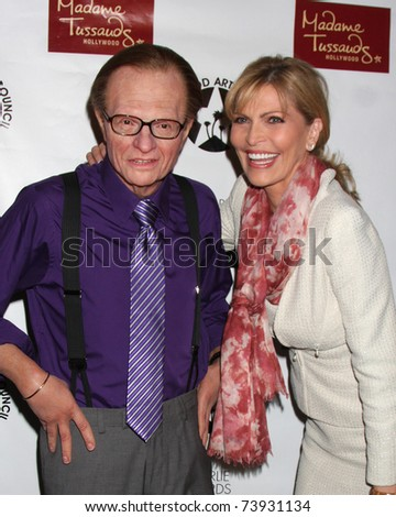 LOS ANGELES - MAR 25:  Larry King Wax figure (Purple shirt) with Shawn Southwick King at the Charlie Awards at Hollywood Roosevelt Hotel on March 25, 2011 in Los Angeles, CA - stock photo