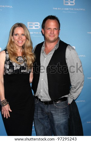 LOS ANGELES - MAR 10:  Lauralee Bell; Scott Martin arrives at the Bold and Beautiful 25th Anniversary Party at the Perch Resturant on March 10, 2012 in Los Angeles, CA
