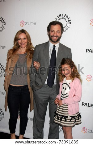 "LOS ANGELES - MAR 12:  Leslie Mann and Judd Apatow, with their daughter arrive at the ""Freaks & Geeks, Undeclared"" PaleyFest 2011 at Saban Theatre on March 12, 2011 in Beverly Hills, CA - stock photo"
