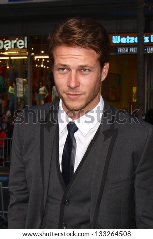 """LOS ANGELES - MAR 28:  Luke Bracey arrives at the """"G.I. Joe: Retaliation""""  LA Premiere at the Chinese Theater on March 28, 2013 in Los Angeles, CA - stock photo"""