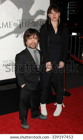 LOS ANGELES - MAR 18 - Peter Dinklage and Erica Schmidt arrives at the Game Of Thrones Season 3 Los Angeles Premiere on March 18,  2013 in Los Angeles, CA