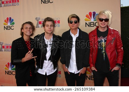 LOS ANGELES - MAR 29:  5 Seconds of Summer at the 2015 iHeartRadio Music Awards at the Shrine Auditorium on March 29, 2015 in Los Angeles, CA - stock photo