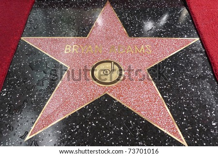 LOS ANGELES - MAR 21: Singer Bryan Adams at a ceremony where he is honored with a star on the Hollywood Walk of Fame in Los Angeles, California on March 21, 2011.