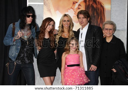 "LOS ANGELES - MAR 25:  Tish & Billy Ray Cyrus, & Family except Miley arrives at  ""The Last Song"" World Premiere at ArcLight Theaters on March 25, 2011 in Los Angeles, CA - stock photo"