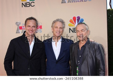 LOS ANGELES - MAR 29:  Tom Poleman, John Sykes, Ian Stewart at the 2015 iHeartRadio Music Awards at the Shrine Auditorium on March 29, 2015 in Los Angeles, CA - stock photo