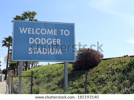 LOS ANGELES - MARCH 17: A welcome sign at the entrance to Dodger Stadium in Los Angeles on March 17, 2014. The stadium has been home to the Dodgers Major League Baseball team since 1962. - stock photo