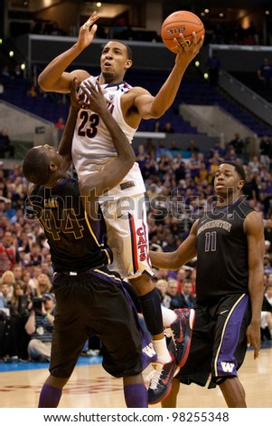 LOS ANGELES - MARCH 12: Arizona Wildcats F Derrick Williams #23 & Washington Huskies F Darnell Gant #44 during the NCAA Pac-10 Tournament basketball championship game between on March 12 2011 in Los Angeles, CA. - stock photo
