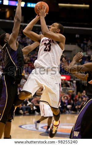 LOS ANGELES - MARCH 12: Arizona Wildcats forward Derrick Williams #23 gets a shot off during the NCAA Pac-10 Tournament basketball championship game on March 12 2011 at Staples Center in Los Angeles, CA. - stock photo