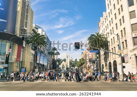 LOS ANGELES - MARCH 21, 2015: crowded street with multiracial people walking on Hollywood Boulevard the world famous Walk of Fame created in 1958 as a tribute to artists working in the movie industry. - stock photo