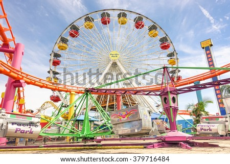 LOS ANGELES - 18 MARCH 2015: detailed frontal view of multicolored ferris wheel at Santa Monica Pier at Pacific Amusement Park - Landmark on the californian coast at the foot of Colorado Avenue - stock photo