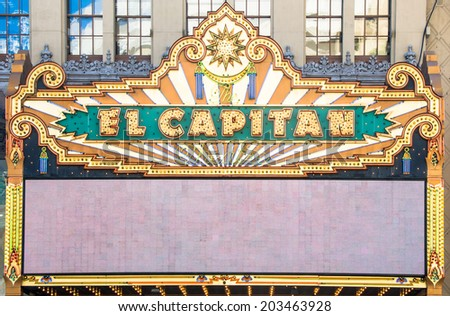 LOS ANGELES - MARCH 30: El Capitan Theater on March 30, 2014 in Hollywood. El Capitan Theater is owned and operated by The Walt Disney Company. - stock photo