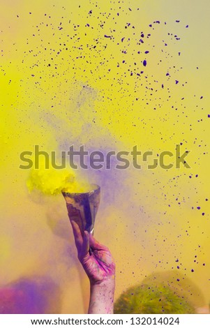 LOS ANGELES - MARCH 16 : Explosion of a packet of colors during the color countdown. Holi Festival of Colors on March 16, 2013 in Los Angeles, CA - stock photo