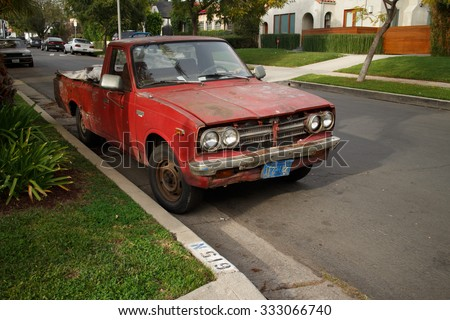 LOS ANGELES - March 10, 2015: Old beaten up pickup truck parked on a street of West Hollywood, CA - stock photo