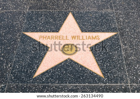 LOS ANGELES - 21 MARCH, 2015: star of Pharrel Williams on the Walk of Fame in Hollywood California. The grammy winning singer songwriter and producer received the celebrity sign at the end of 2014. - stock photo