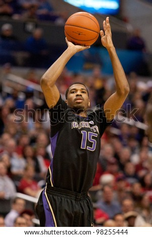 LOS ANGELES - MARCH 12: Washington Huskies G Scott Suggs #15 in action during the NCAA Pac-10 Tournament basketball championship game on March 12 2011 at Staples Center in Los Angeles, CA. - stock photo