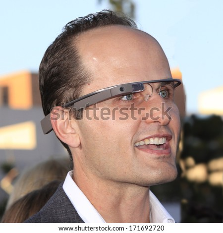 LOS ANGELES - MAY 29: A man is seen wearing Google Glass at the premiere of 'The Internship' at the Regency Village Westwood on May 29, 2013 in Los Angeles, California - stock photo