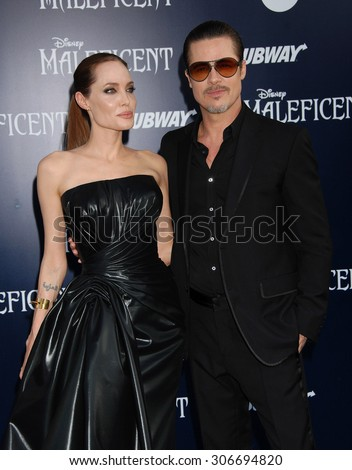 LOS ANGELES - MAY 28:  Angelina Jolie and Brad Pitt arrives at the Maleficent WORLD Premiere  on May 28, 2014 in Hollywood, CA                 - stock photo