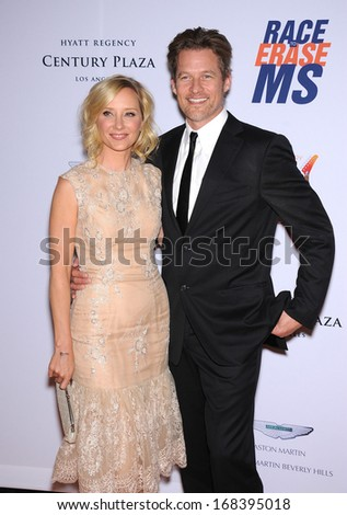 LOS ANGELES - MAY 03:  Anne Heche & James Tupper arrives to the Race To Erase MS 2013  on May 03, 2013 in Century City, CA