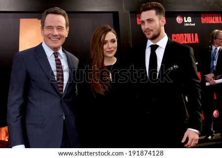 """LOS ANGELES - MAY 8:  Bryan Cranston, Elizabeth Olsen, Aaron Taylor-Johnson at the """"Godzilla"""" Premiere at Dolby Theater on May 8, 2014 in Los Angeles, CA - stock photo"""
