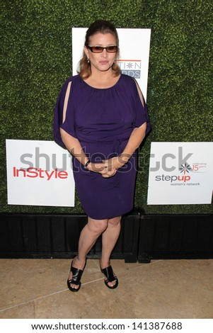 LOS ANGELES - MAY 31:  Carrie Fisher arrives at the 10th Annual Inspiration Awards Luncheon at the Beverly Hilton Hotel on May 31, 2013 in Beverly Hills, CA - stock photo