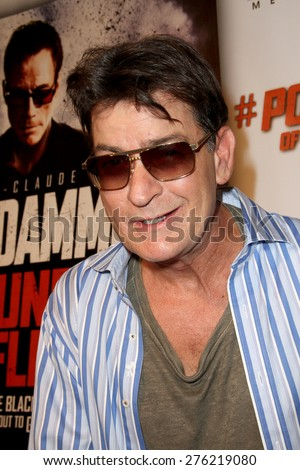 """LOS ANGELES - MAY 7: Charlie Sheen attends the premiere of """"Pound of Flesh"""" at The Grove Pacific Theaters in Los Angeles on May 7, 2015.  - stock photo"""