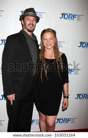 LOS ANGELES - MAY 19:  Crystal Bowersox & Husband arrives at the JDRF's 9th Annual Gala at Century Plaza Hotel on May 19, 2012 in Century City, CA - stock photo