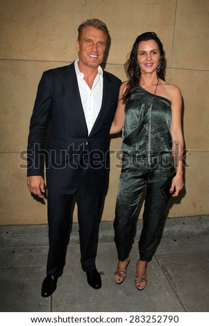 """LOS ANGELES - MAY 6:  Dolph Lundgren, Jenny Sanderson at the """"Skin Trade"""" Los Angeles Premiere at the Egyptian Theater on May 6, 2015 in Los Angeles, CA - stock photo"""