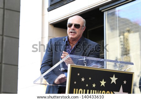 LOS ANGELES - MAY 13: Dr Phil McGraw at a ceremony where Steve Harvey is honored with a star on the Hollywood Walk Of Fame on May 13, 2013 in Los Angeles, California - stock photo