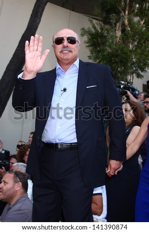 LOS ANGELES - MAY 31:  Dr. Phil McGraw at the David Foster Hollywood Walk of Fame Star Ceremony at the Capital Records Building on May 31, 2013 in Los Angeles, CA - stock photo