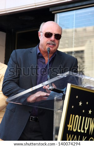 LOS ANGELES - MAY 13:  Dr. Phil McGraw at the Steve Harvey Hollywood Walk of Fame Star Ceremony at the W Hollywood Hotel  on May 13, 2013 in Los Angeles, CA - stock photo