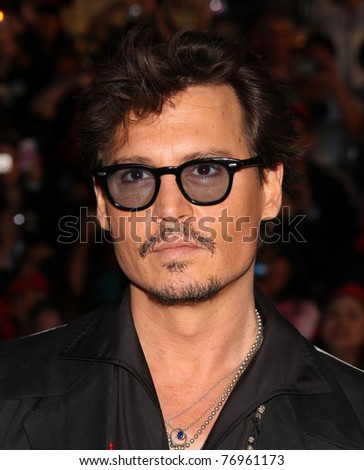 "LOS ANGELES - MAY 07:  Johnny Depp arrives to the ""Pirates of the Caribbean: On Stranger Tides"" World Premiere  on May 7, 2011 in Anaheim, CA - stock photo"